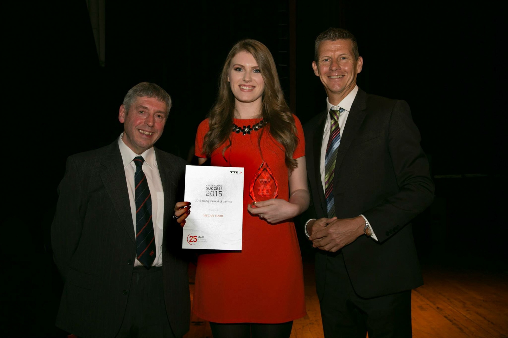 Photo of Megan recieving an award
