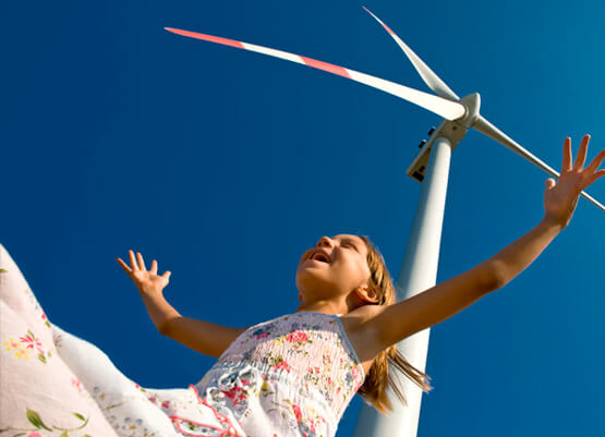 Young girl at a wind turbine