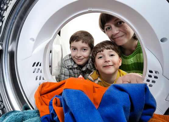 Family looking into a washing machine