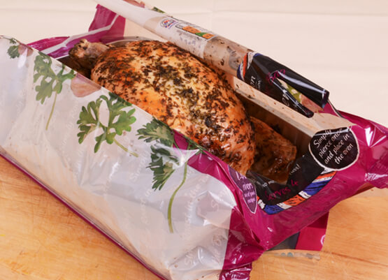Cooked chicken in a polyester bag